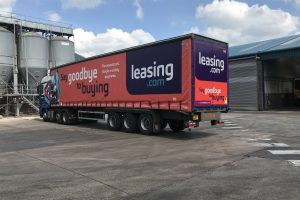 Truck stands ready to leave the depot with Leasing.com livery